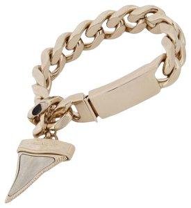 Givenchy Givenchy's flat curb-link bracelet features a shark tooth-shaped pendant.