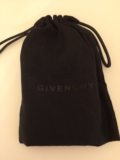 Givenchy Givenchy's flat curb-link bracelet features a shark tooth-shaped pendant. Image 8