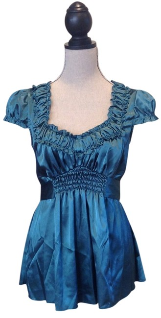 Preload https://item3.tradesy.com/images/xoxo-turquoise-night-out-top-size-8-m-691092-0-0.jpg?width=400&height=650