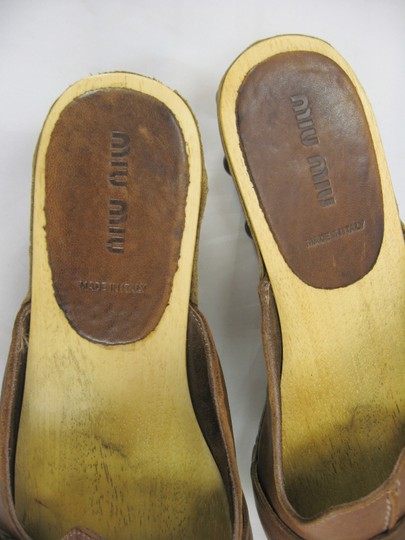 Miu Miu Prada House Distressed Leather Sandals Brown Mules