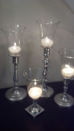 Preload https://img-static.tradesy.com/item/69468/silver-candlesticks-white-tapers-votive-peg-cups-centerpiece-0-0-540-540.jpg