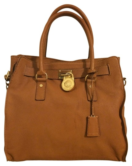 Preload https://item1.tradesy.com/images/michael-kors-mk-brown-leather-purse-shoulder-bag-luggage-696605-0-0.jpg?width=440&height=440