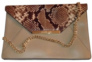 Michael Kors Page And Brown Clutch
