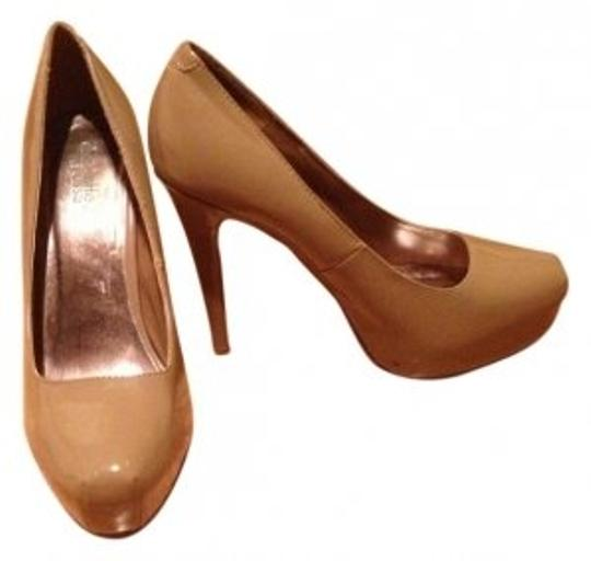 Preload https://img-static.tradesy.com/item/6981/charlotte-russe-buff-tan-run-small-pumps-size-us-9-regular-m-b-0-0-540-540.jpg