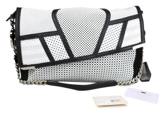 Preload https://item3.tradesy.com/images/jimmy-choo-ally-black-and-perforated-white-leather-shoulder-bag-6986092-0-1.jpg?width=440&height=440