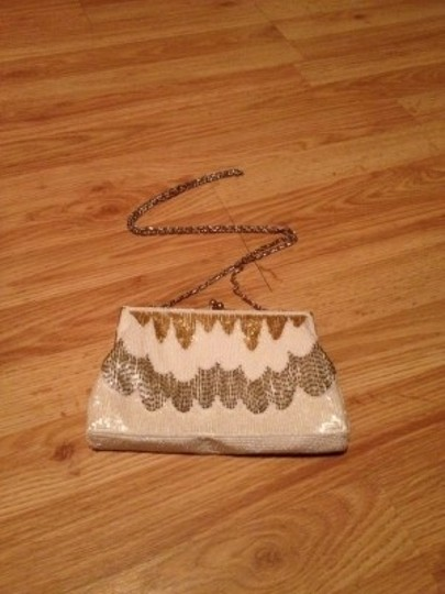 La Regale cream, copper and gold Clutch