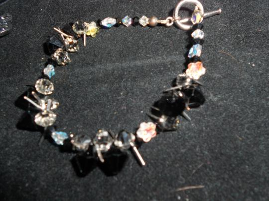 Other BRILLANT AB MULTI FACETED BLACK/PURPLE CRYSTAL BRACELET AND CRYSTAL DOLPHIN RING
