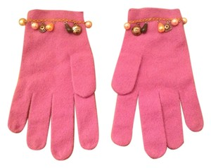 White + Warren White and Warren cashmere gloves with decorative charms along the wrist region.