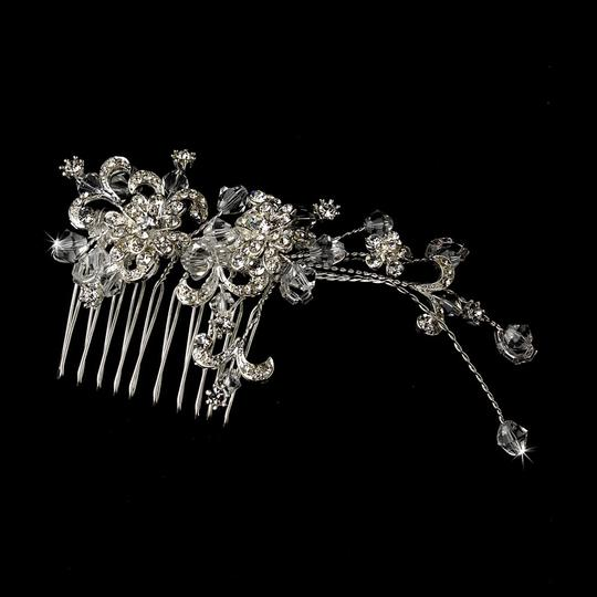 Preload https://item3.tradesy.com/images/silver-glittering-austrian-crystal-rhinestone-floral-comb-hair-accessory-703407-0-0.jpg?width=440&height=440