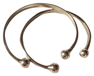 Other a pair (TWO) of Sterling Silver bangle bracelets, each designed with an open front (Fits most sizes)