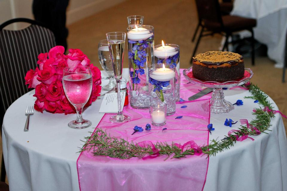 Centerpieces for pink and navy blue wedding guests