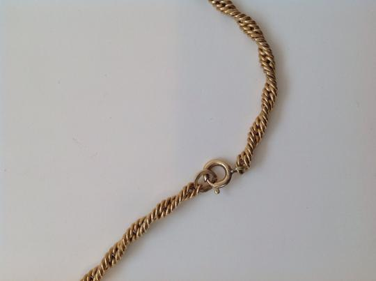 Other 1/20 14 k gold braided rope necklace.