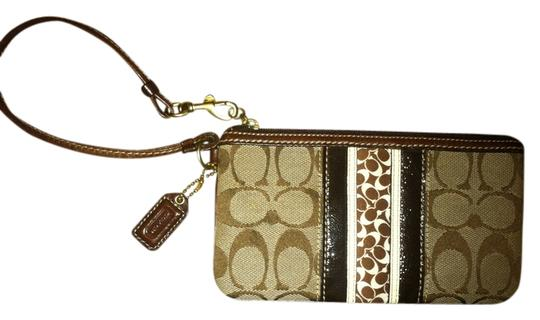 Preload https://img-static.tradesy.com/item/708556/coach-brown-and-white-stitchleather-wristlet-0-0-540-540.jpg