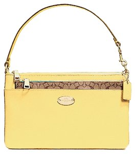 Coach Wristlet in Pale Yellow