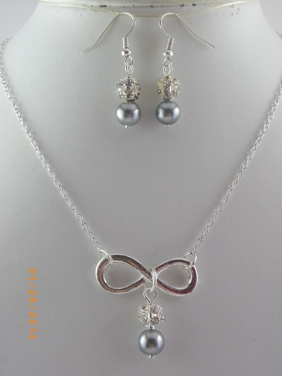 Preload https://img-static.tradesy.com/item/709881/grey-sale-of-6-infinity-bridesmaid-necklace-and-earrings-6-infinity-charm-necklace-of-6-bridesmaid-n-0-0-540-540.jpg