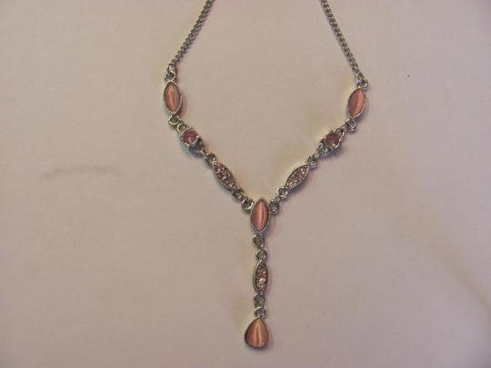 Preload https://item2.tradesy.com/images/silver-with-pink-stones-new-on-card-chain-drop-necklace-711146-0-0.jpg?width=440&height=440