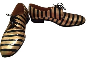 Dieppa Restrepo Gold and Black Patent Flats