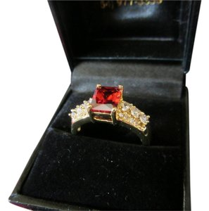 14 kt gold HUGE SALE!!! Clearing out everything! 14kt Yellow gold ring with stunning crystals and (probably lab made) garnet