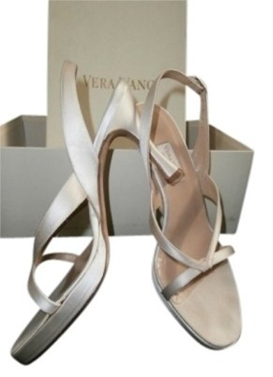 Preload https://item4.tradesy.com/images/vera-wang-white-strappy-wedding-sandals-size-us-5-regular-m-b-7158-0-0.jpg?width=440&height=440