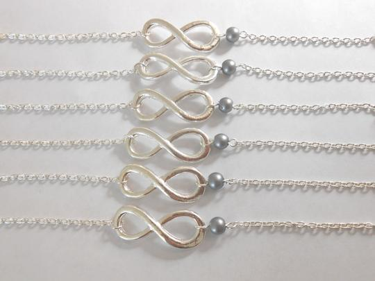 Preload https://item1.tradesy.com/images/grey-sale-set-of-6-bridesmaid-pearl-infinity-charm-bridesmaid-of-6-infinity-bracelet-716035-0-0.jpg?width=440&height=440