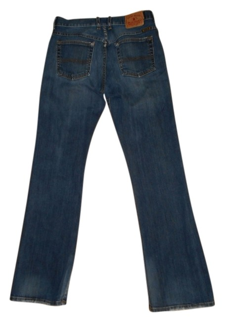 Preload https://item3.tradesy.com/images/blue-dark-rinse-flare-leg-jeans-size-30-6-m-717107-0-0.jpg?width=400&height=650