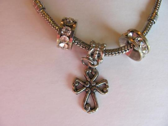 Other BRACELET WITH A CROSS / 2 RHINESTONE RINGS