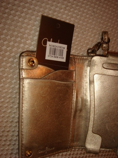 Cole Haan Gold Cole Haan celphone accessories , fit in 3G iphone