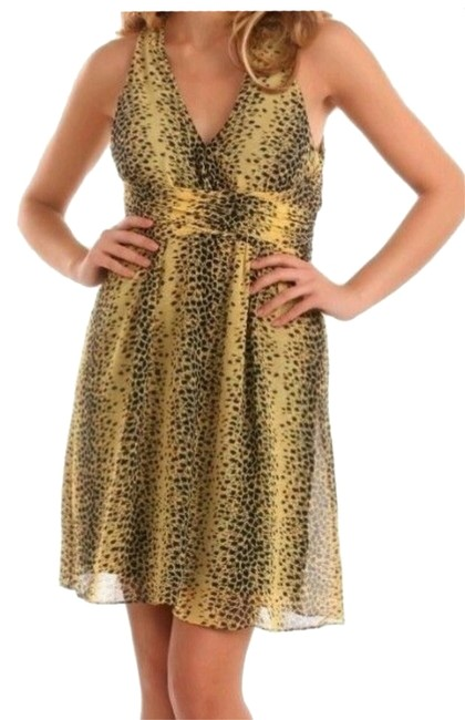 Preload https://img-static.tradesy.com/item/7180915/guess-yellow-and-black-leopard-print-padded-mini-cocktail-dress-size-4-s-0-1-650-650.jpg