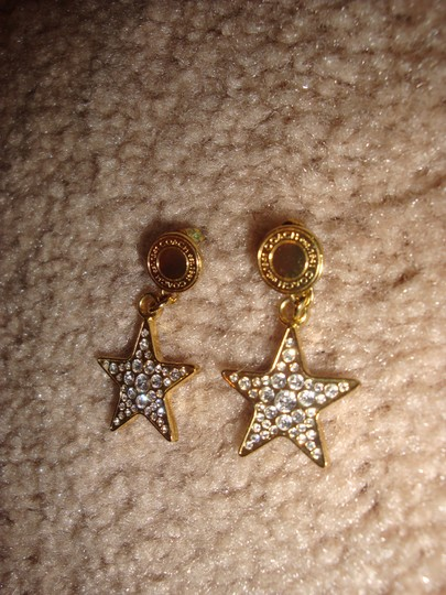 Coach star earrings