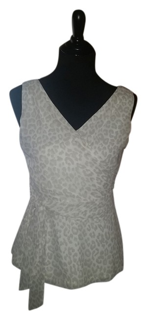 Preload https://img-static.tradesy.com/item/7243153/express-cream-night-out-top-size-4-s-0-1-650-650.jpg
