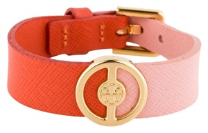 Tory Burch Gold-tone Reva logo Tory Burch pink orange leather colorblock cuff bracelet New