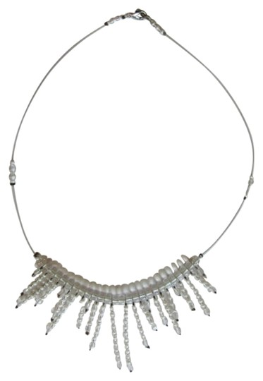 Preload https://item3.tradesy.com/images/white-clear-floating-bib-necklace-727677-0-0.jpg?width=440&height=440