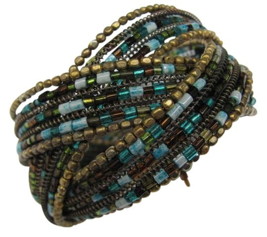 Preload https://img-static.tradesy.com/item/731291/brown-gold-turquoise-wire-cuff-with-beads-bracelet-0-0-540-540.jpg