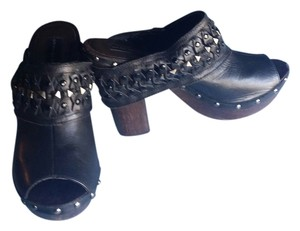 Steve Madden Unique Leather And Studded Band Covering Front And Chunky Wood Look Heel. Black Mules