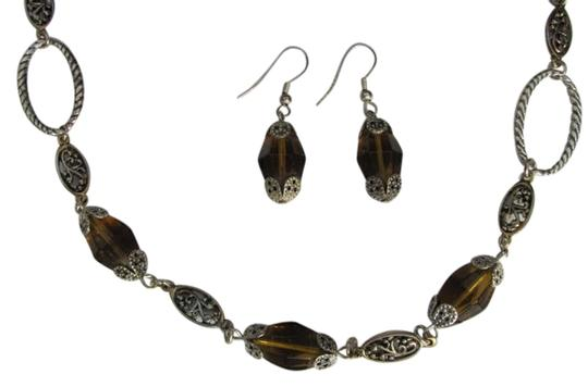 Preload https://item4.tradesy.com/images/silver-topaz-and-earring-set-necklace-732328-0-0.jpg?width=440&height=440