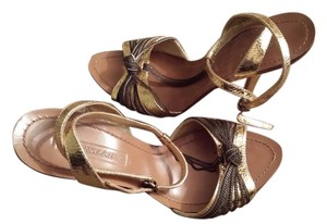 BCBGMAXAZRIA Leather Golden Sandals