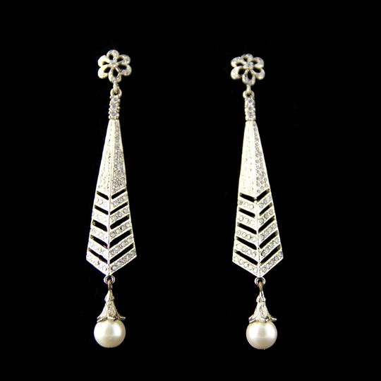 Preload https://item3.tradesy.com/images/silver-american-diamond-studded-with-pearl-drops-eiffel-tower-earrings-735652-0-0.jpg?width=440&height=440