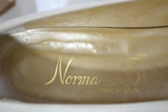 Norman B White Pumps