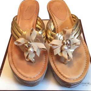 Coach Gold and tan Wedges