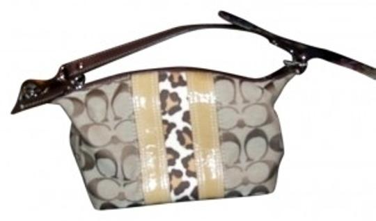 Preload https://item4.tradesy.com/images/coach-brown-gold-w-leopard-wristlet-7403-0-0.jpg?width=440&height=440