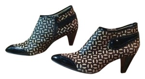 Franco Sarto Black and Tan Pumps