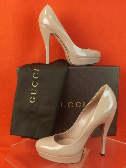 Preload https://img-static.tradesy.com/item/7466680/gucci-beige-patent-leather-lisbeth-platform-classic-3099995-pumps-size-eu-415-approx-us-115-regular-0-1-540-540.jpg
