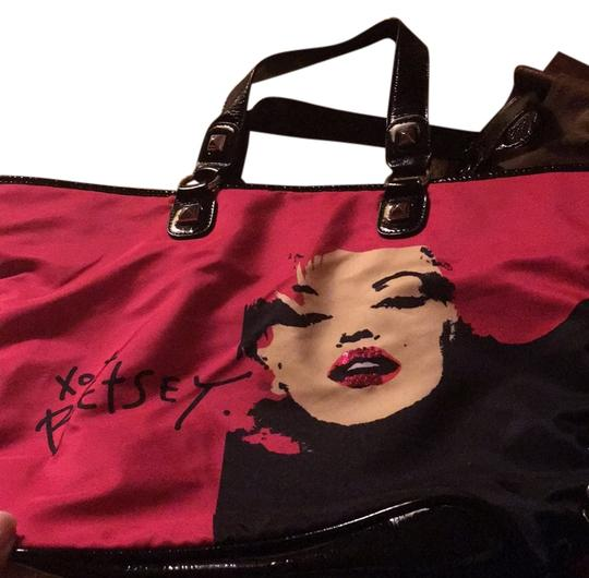 Preload https://img-static.tradesy.com/item/7542934/betsey-johnson-laced-up-on-the-sides-tote-pink-and-black-polyester-weekendtravel-bag-0-2-540-540.jpg