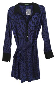 The Letter short dress Navy (Purple-ish) Silk Cheetah Print Shirt Purple on Tradesy