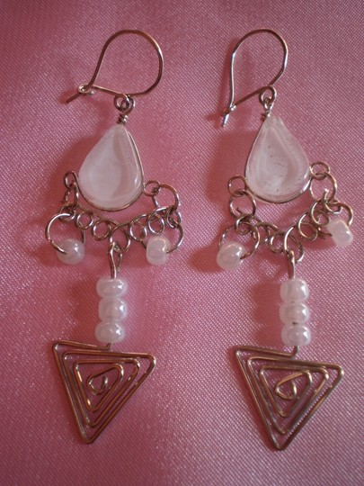Preload https://img-static.tradesy.com/item/762121/like-new-dangle-earrings-0-0-540-540.jpg