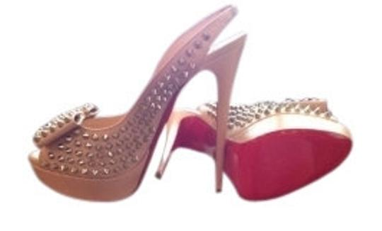 Preload https://item4.tradesy.com/images/christian-louboutin-nude-clou-noeud-spikes-pumps-size-us-11-regular-m-b-7628-0-0.jpg?width=440&height=440