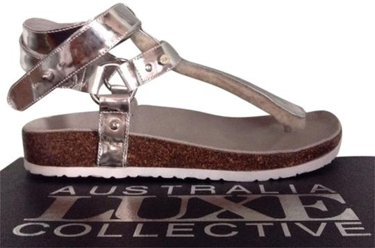 Preload https://item3.tradesy.com/images/australia-luxe-collective-silver-new-chica-genuine-shearling-lined-sandals-size-us-7-narrow-aa-n-7637017-0-0.jpg?width=440&height=440