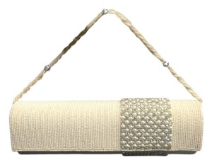Sushma Patel White Clutch