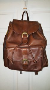 Frye Leather Drawstring Closure Magnetic Snap Closure Side Zip Pocket Outside Snap Closure Pocket Inside Attached Coin Backpack