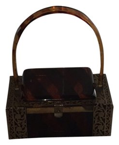 Lucite Vintage, this is a collectors item. Still in good shape, beautiful brown lucite with bronze panels. Brown Clutch